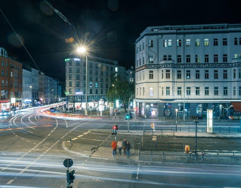 Berlin Rosenthaler Platz at night. BERLIN - October 8, 2016: Traffic moves through Rosenthaler Platz (Rosenthal Square) in Berlin on the night of October 8, 2016 stock photos