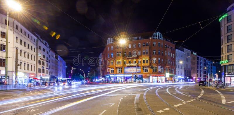 Berlin Rosenthaler Platz at night. BERLIN - October 8, 2016: Traffic moves through Rosenthaler Platz (Rosenthal Square) in Berlin on the night of October 8, 2016 royalty free stock photos