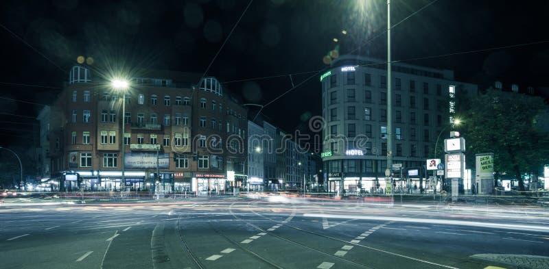 Berlin Rosenthaler Platz at night. BERLIN - October 8, 2016: Traffic moves through Rosenthaler Platz (Rosenthal Square) in Berlin on the night of October 8, 2016 royalty free stock photo