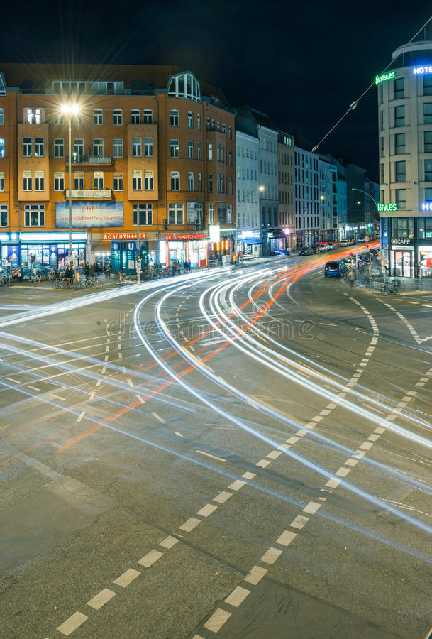 Berlin Rosenthaler Platz at night. BERLIN - October 8, 2016: Traffic moves through Rosenthaler Platz (Rosenthal Square) in Berlin on the night of October 8, 2016 royalty free stock photography