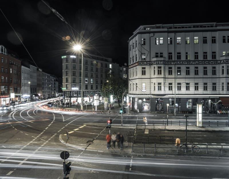 Berlin Rosenthaler Platz at night. BERLIN - October 8, 2016: Traffic moves through Rosenthaler Platz (Rosenthal Square) in Berlin on the night of October 8, 2016 stock photo