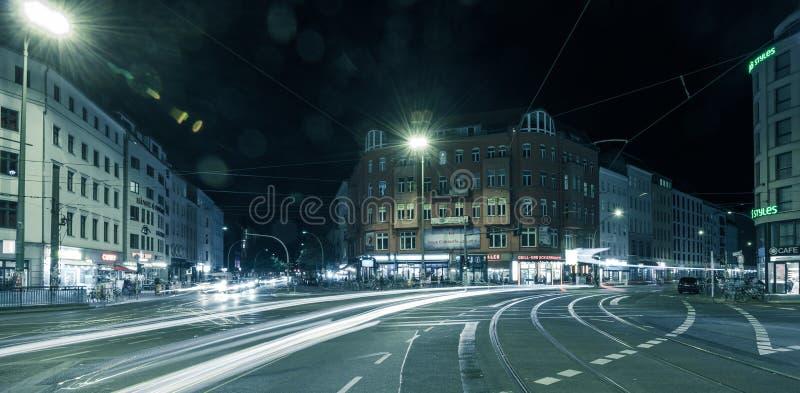 Berlin Rosenthaler Platz at night. BERLIN - October 8, 2016: Traffic moves through Rosenthaler Platz (Rosenthal Square) in Berlin on the night of October 8, 2016 royalty free stock image