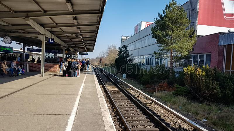 Berlin Schonefeld Airport Trainstation S Bahn. Tourists taking the train that connects the airport to the city centre royalty free stock images