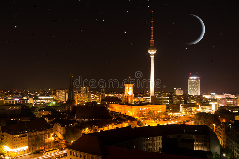 Berlin skyline with moon and stars. By night stock photos