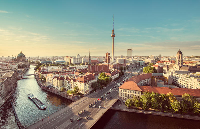 Berlin skyline with Spree river at sunset, Germany. Aerial view of Berlin skyline with famous TV tower and Spree river in beautiful evening light at sunset with stock image