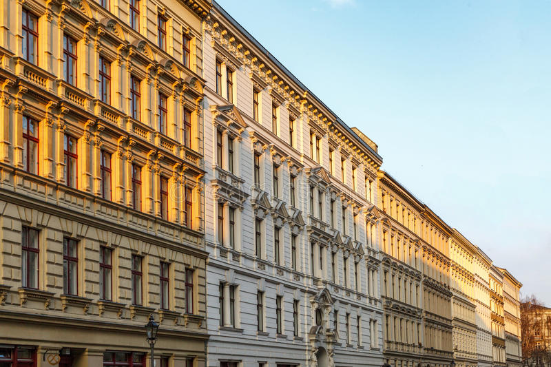 Berlin street sunrise. Traditional apartment buildings in Berlin at sunrise stock images