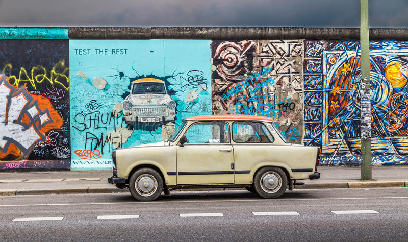 Berlin Wall at East Side Gallery with an old Trabant, Germany stock photography