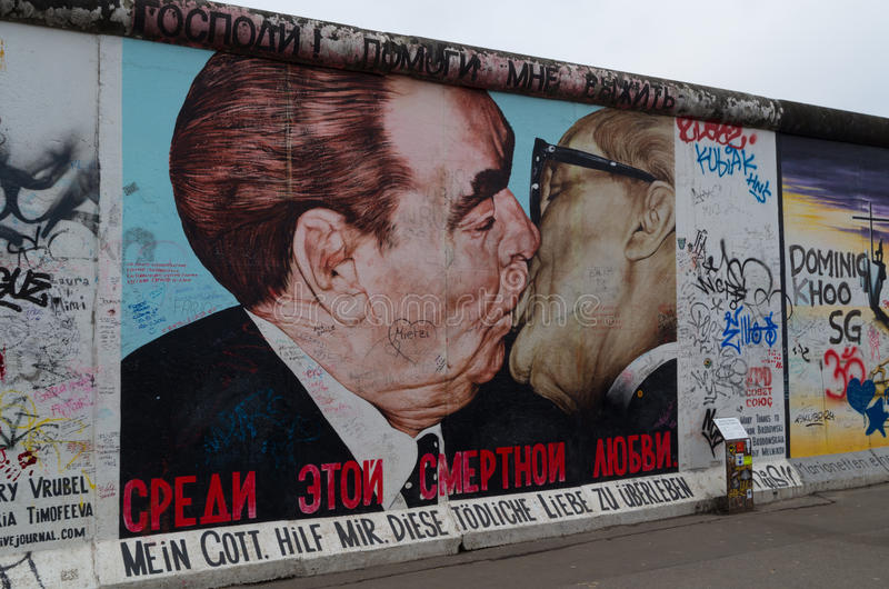 Berlin wall graffiti, East Side Gallery, The Kiss stock photos