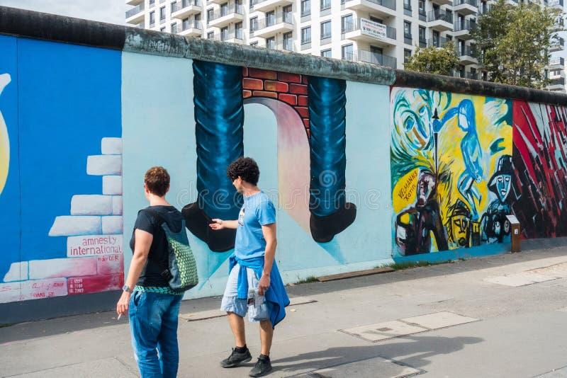 Berlin wall graffiti stock images