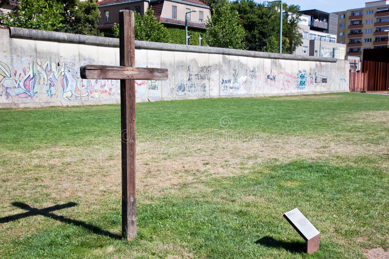 Berlin Wall Memorial. With graffiti and cross commemorating the deaths and division. The Gedenkstatte Berliner Mauer stock photography