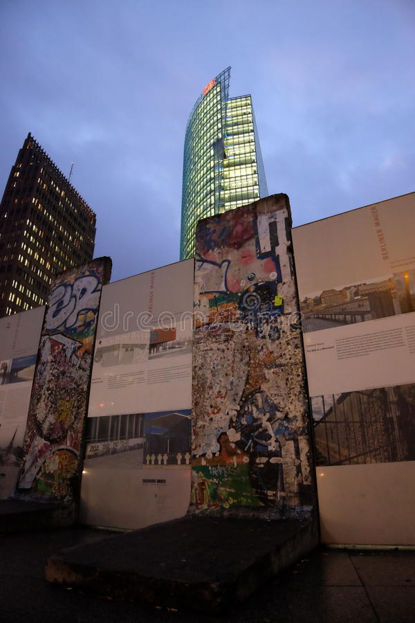 Berlin Wall, Potsdamer Platz. Sections of the Berlin Wall being displayed in front of the high tech background of Potsdamer Platz, Berlin royalty free stock photography