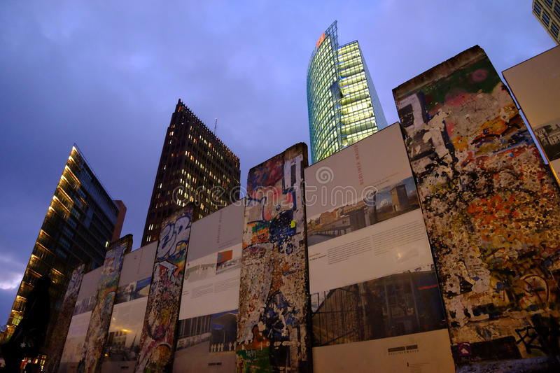 Berlin Wall, Potsdamer Platz. Sections of the Berlin Wall being displayed in front of the high tech background of Potsdamer Platz, Berlin stock photo