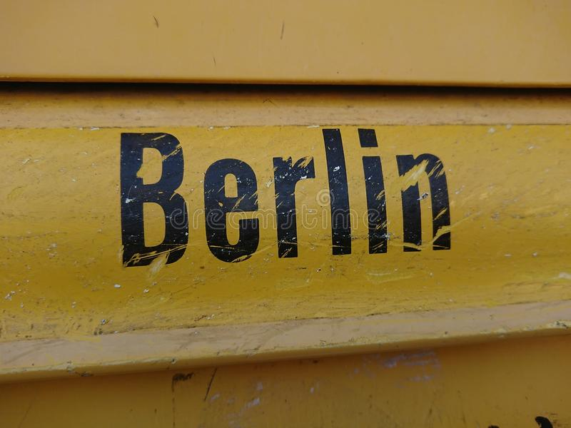 Berlin written text on yellow surface. Close-up stock photo