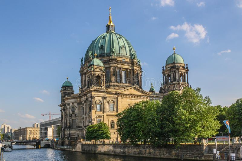 Berliner cathedral seen from across the spree stock images
