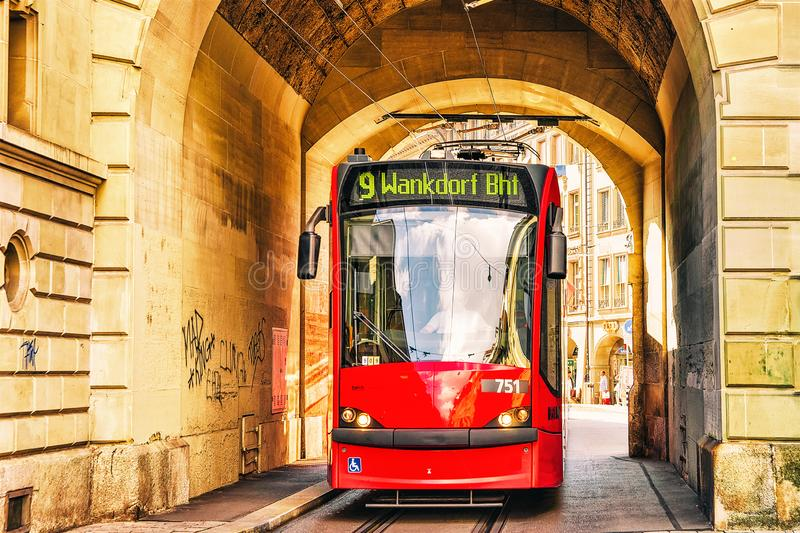 Bern, Switzerland - August 31, 2016: Running tram at the gate on Kramgasse street in old city center of Bern, Switzerland royalty free stock photos