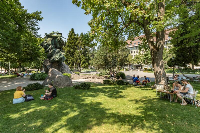 Bern, Switzerland - July 26, 2019: Panoramic view at sunny summer day. Universal Post Monument in Kleine Schanze city Park royalty free stock photos