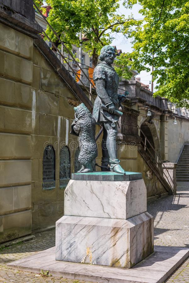 Zahringer Denkmal Statue - Bern - Switzerland. Bern, Switzerland - May 26, 2016: The bear, that is the city symbol, stands behind the founder of Bern, at royalty free stock image