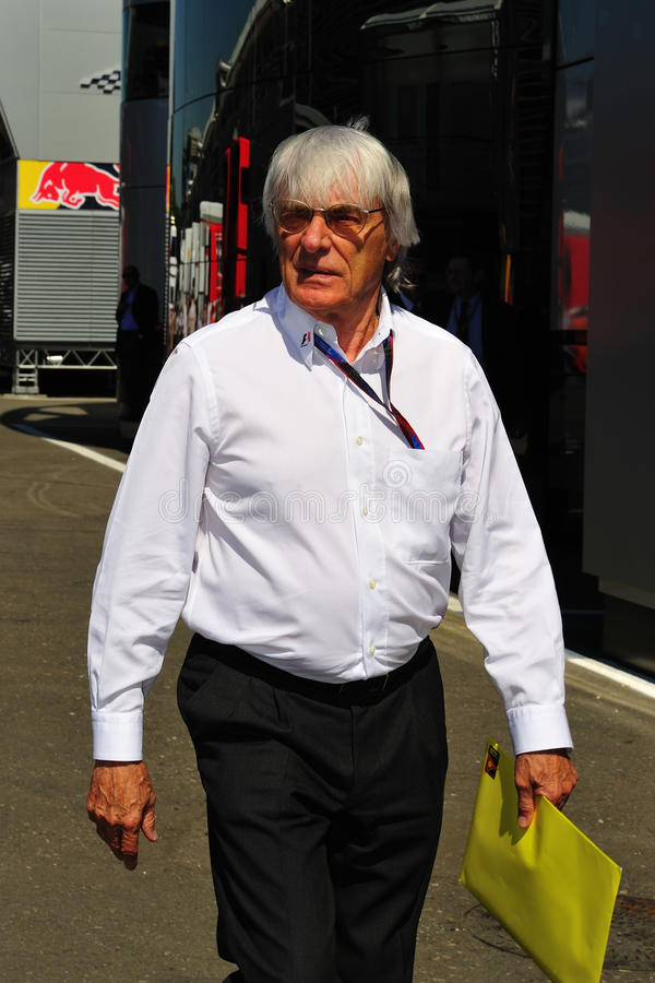 Bernie Ecclestone. Checking the paddock at the circuit before starting the formula 1 championship in monza, italy royalty free stock image