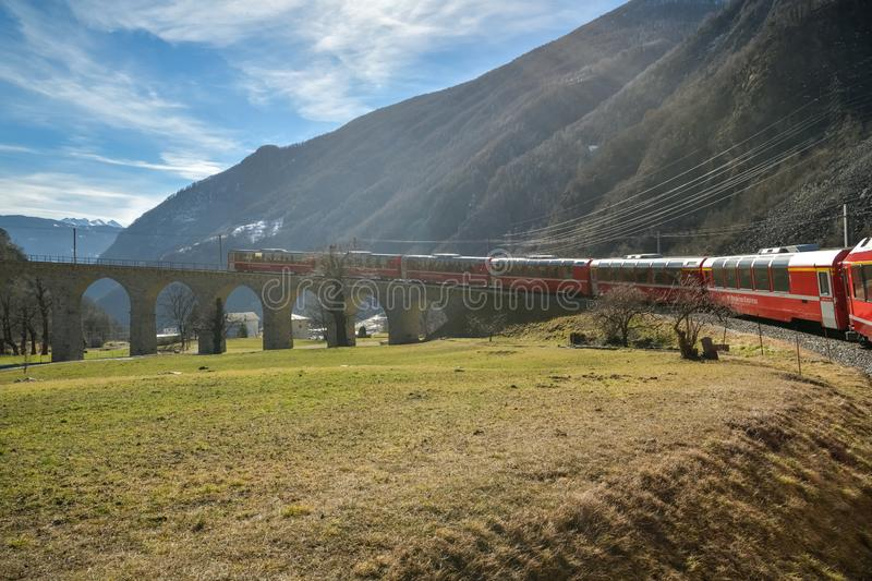 Bernina Express train riding down the famous Brusio spiral viaduct stock images