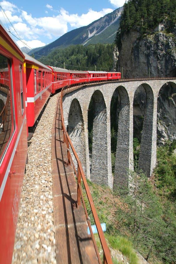 Bernina Express train on the Swiss alps stock photos