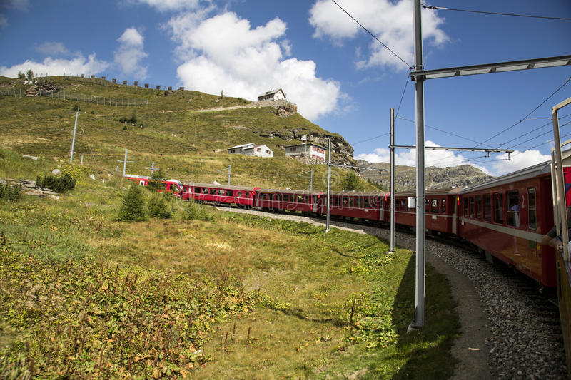 Bernina Railway. The Bernina railway is part of the Rhaetian Railway RhB. It links St. Moritz, in the Canton of Graubünden, Switzerland, with the town of royalty free stock images