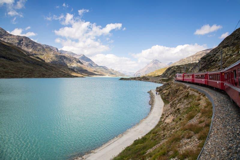 Bernina Railway. The Bernina railway is part of the Rhaetian Railway RhB. It links St. Moritz, in the Canton of Graubünden, Switzerland, with the town of stock photo