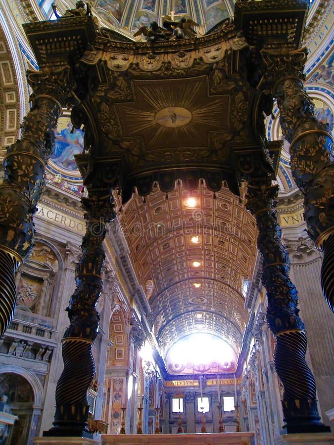 Bernini's Baldacchino, St Peter's Basilica, Rome, Italy. St. Peter's Basilica is shaped like a cross, with the very center positioned over the tomb stock image