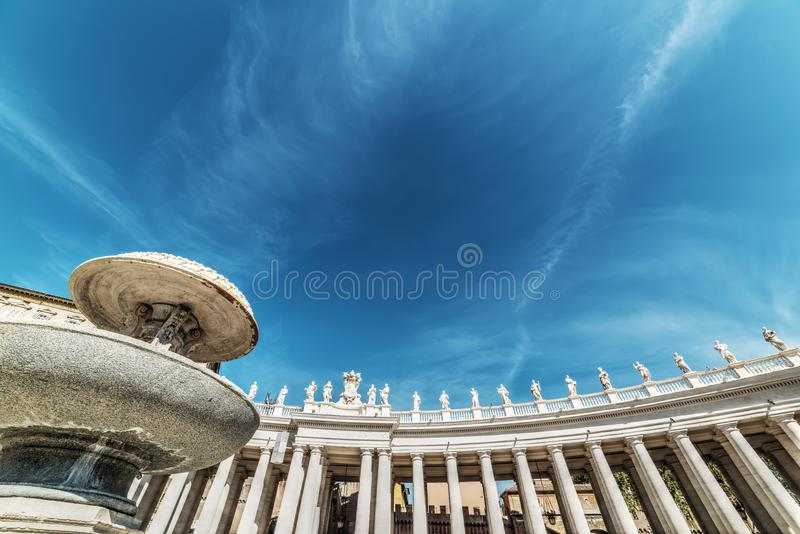 Bernini fountain in Saint Peter`s square with colonnade on the b royalty free stock photo