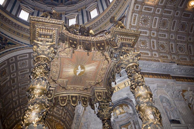 Bernini's baldacchino, inside Saint Peter's Basilica, Vatican. Vatican,Italy-April 04,2014:Bernini's baldacchino, inside Saint Peter's Basilica royalty free stock photo