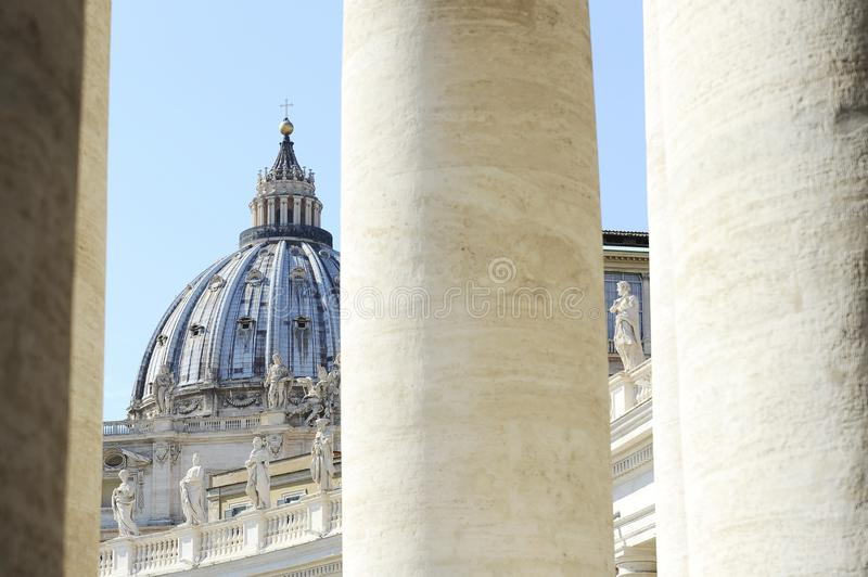 The Bernini`s columns against saint peter`s Basilica. Vatican city royalty free stock photography