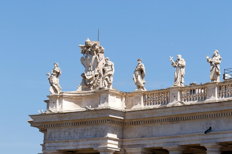 Artwork on top of Bernini`s colonnade in Vatican City. Bernini`s sculptures on top of the colonnade in Piazza San Pietro St. Peter`s Square in the Vatican City stock photo