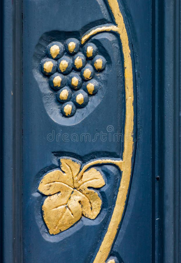Bernkastel home decoration of golden leaves and grape vines. On door stock image