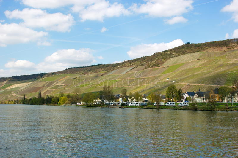 Bernkastel-Kues on the river Mosel, surrounded by the wine yards. View of Bernkastel-Kues on Mosel river, Germany on a sunny day royalty free stock photos