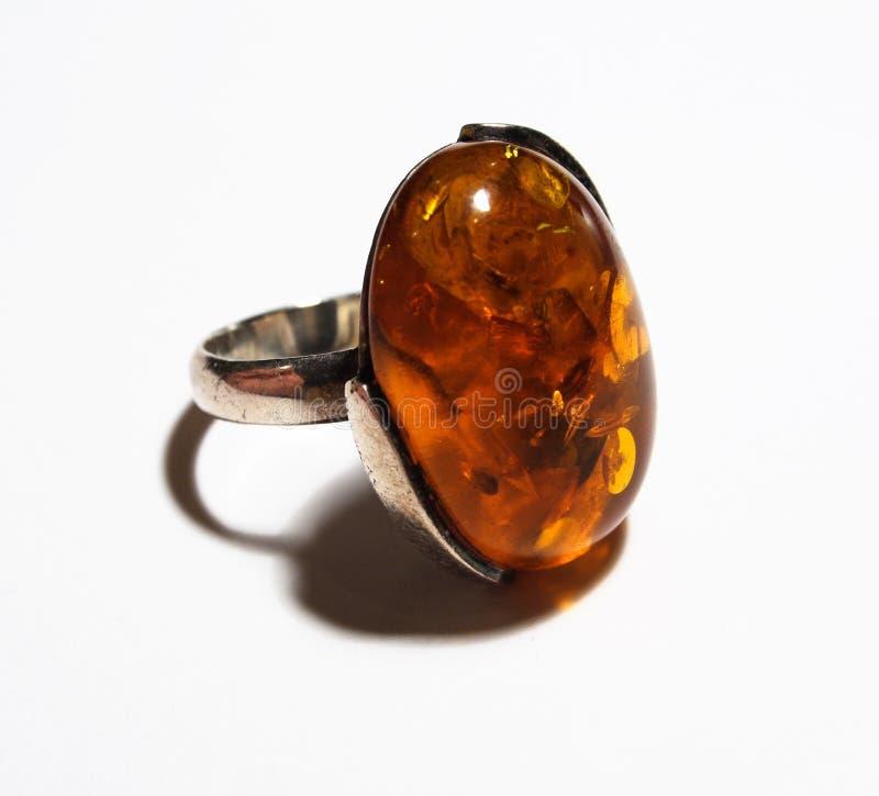 Bernsteinfarbiger Ring stockbilder