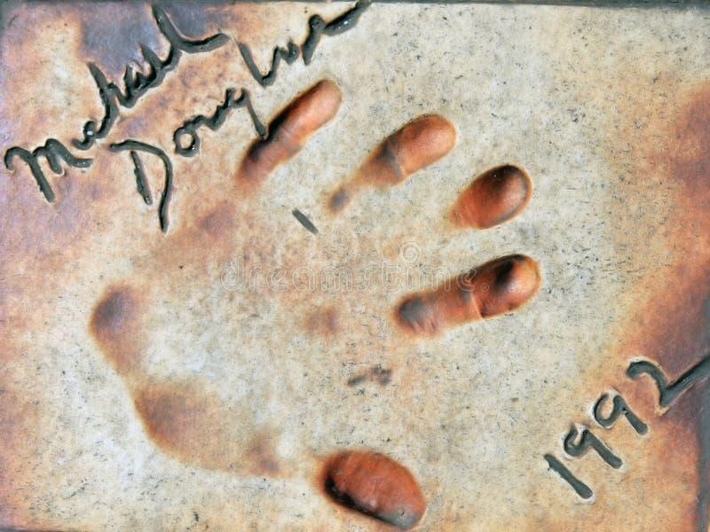 Beroemde Hand die op een grond wordt afgedrukt stock fotografie