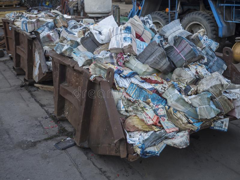 Beroun, Czech Republic, March 23, 2019: old rusty container full of stack waste paper for recycling royalty free stock photos