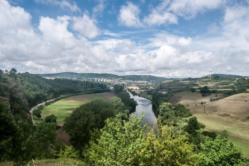 Berounka river with Beroun city on the background in Central Bohemia. Berounka river with countryside around, Beroun city and hills on the background from royalty free stock image