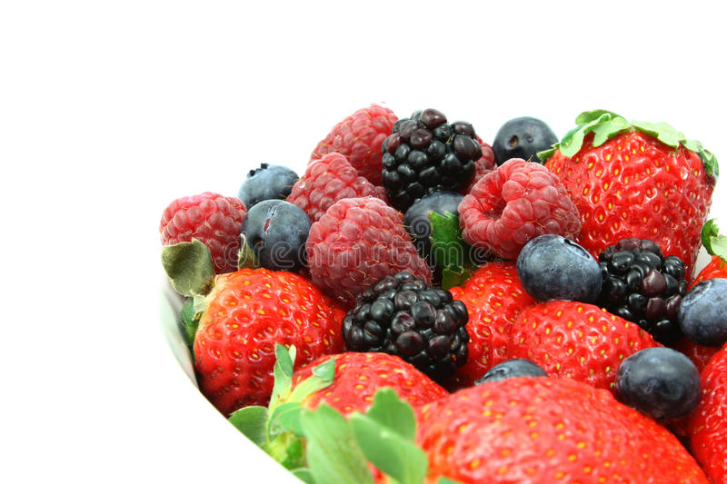 Berries. Mixed fresh berries displayed on a white background stock photos