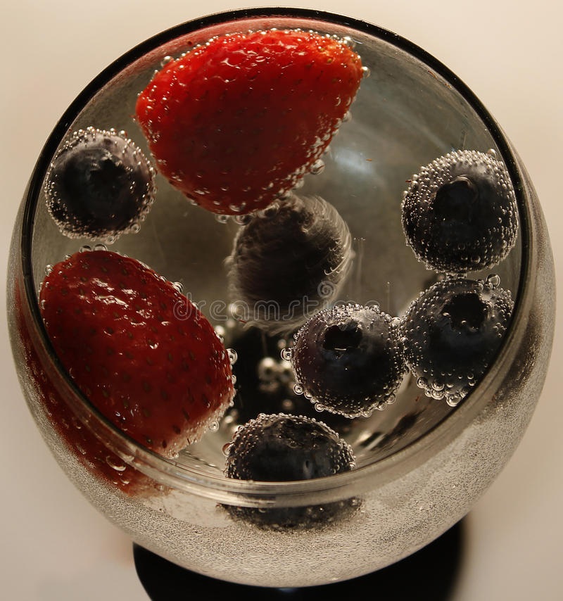 Berries in bubbles stock photos