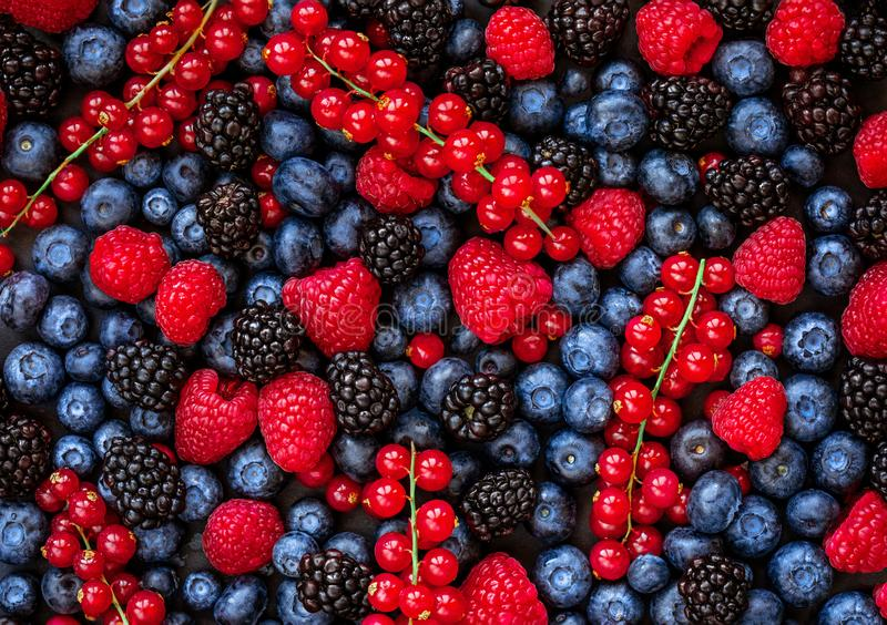 Berries overhead Background. Fresh Summer Berry mix with Strawberry, Raspberry, Red currant, Blueberry and Blackberry, top view royalty free stock images