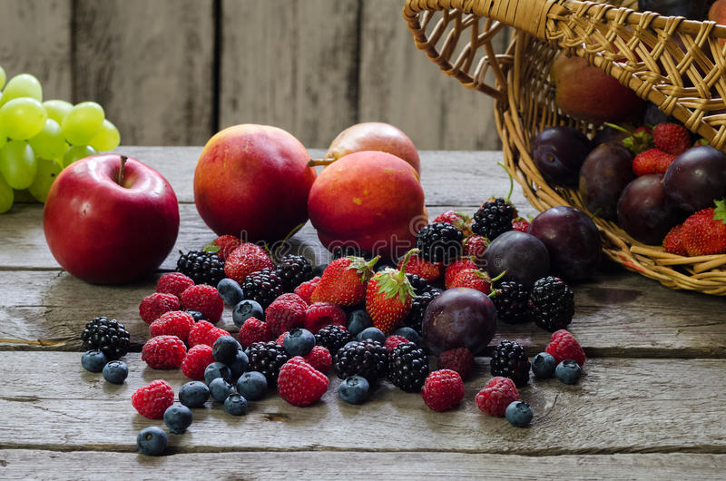 Berries, summer fruit on wooden table. healthy lifestyle concept. stock images