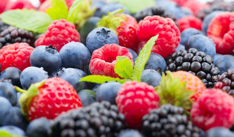 Berries. Various colorful berries background. Mint leaves, Strawberry, Raspberry, Blackberry, Blueberry close-up backdrop. Fresh Bio Fruits, Healthy eating stock images
