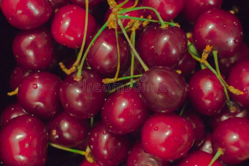 Berry background. Ripe sweet cherry. Summer berry. The use of cherries. Garden harvest. Fresh berries. Harvest of sweet cherries. Background of ripe cherries stock photo