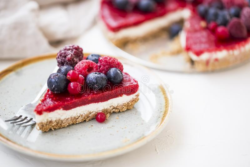Berry cheesecake slice, fresh frozen red fruits and cheese cake slice stock image