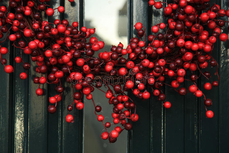 Berry christmas wreath stock photography