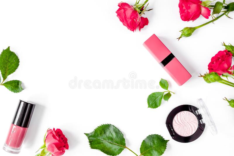 Berry color decorative cosmetics with roses white background top. Berry color decorative cosmetics with roses on white background top view stock photos