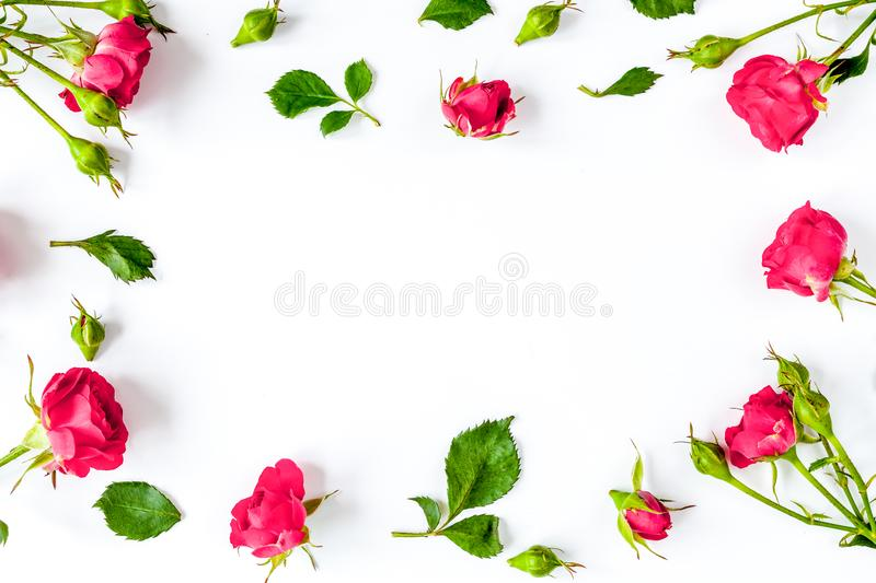 Berry color decorative cosmetics with roses white background top. Berry color decorative cosmetics with roses on white background top view royalty free stock photo