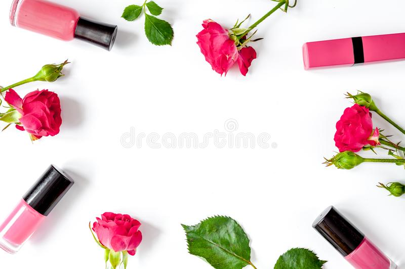 Berry color decorative cosmetics with roses white background top. Berry color decorative cosmetics with roses on white background top view royalty free stock photos