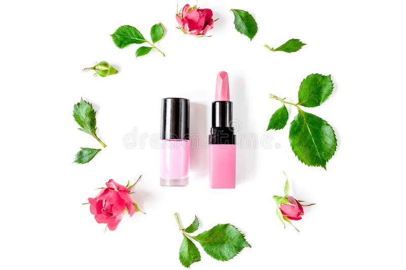 Berry color decorative cosmetics with roses white background top. Berry color decorative cosmetics with roses on white background top view stock photography