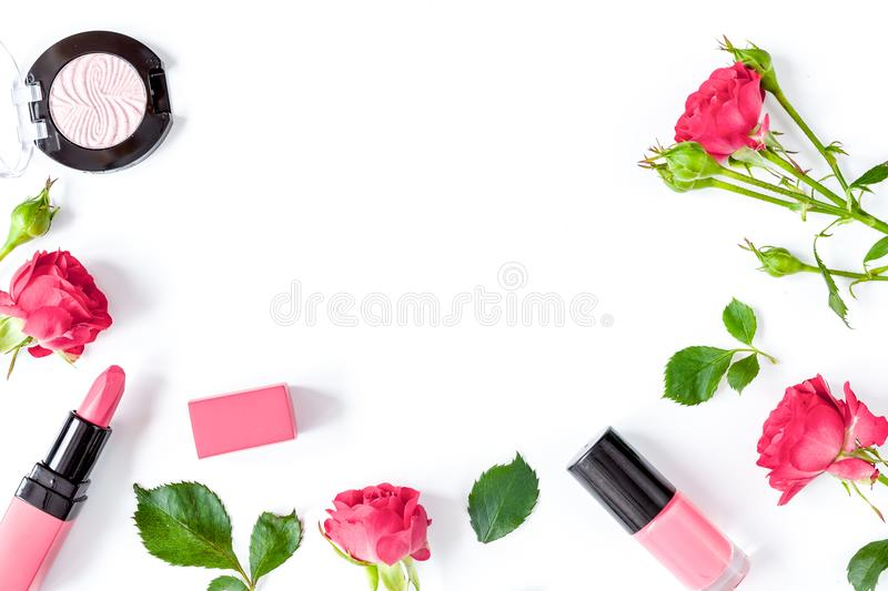 Berry color decorative cosmetics with roses white background top. Berry color decorative cosmetics with roses on white background top view stock photo